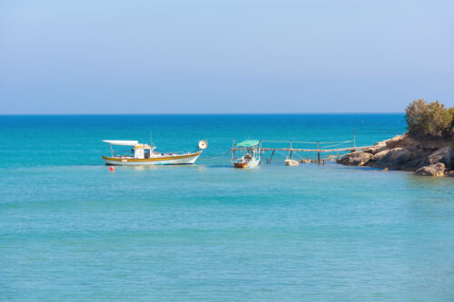 Fishing boat at calm sea. Mediterranean - slon.pics - free stock photos and illustrations