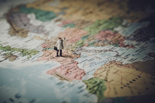 Miniature businessman on map of Europe - slon.pics - free stock photos and illustrations