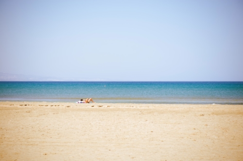 Undefined lady laying at the summer beach - slon.pics - free stock photos and illustrations