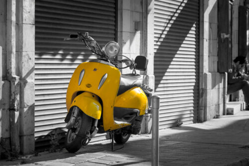 Vintage yellow scooter in the old street - slon.pics - free stock photos and illustrations