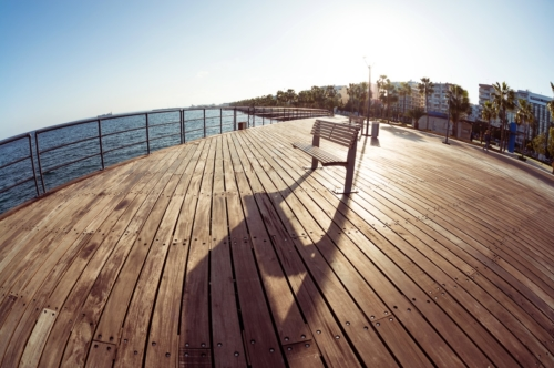 Lonely empty bench at seaside pier. Mediterranean sea coast - slon.pics - free stock photos and illustrations