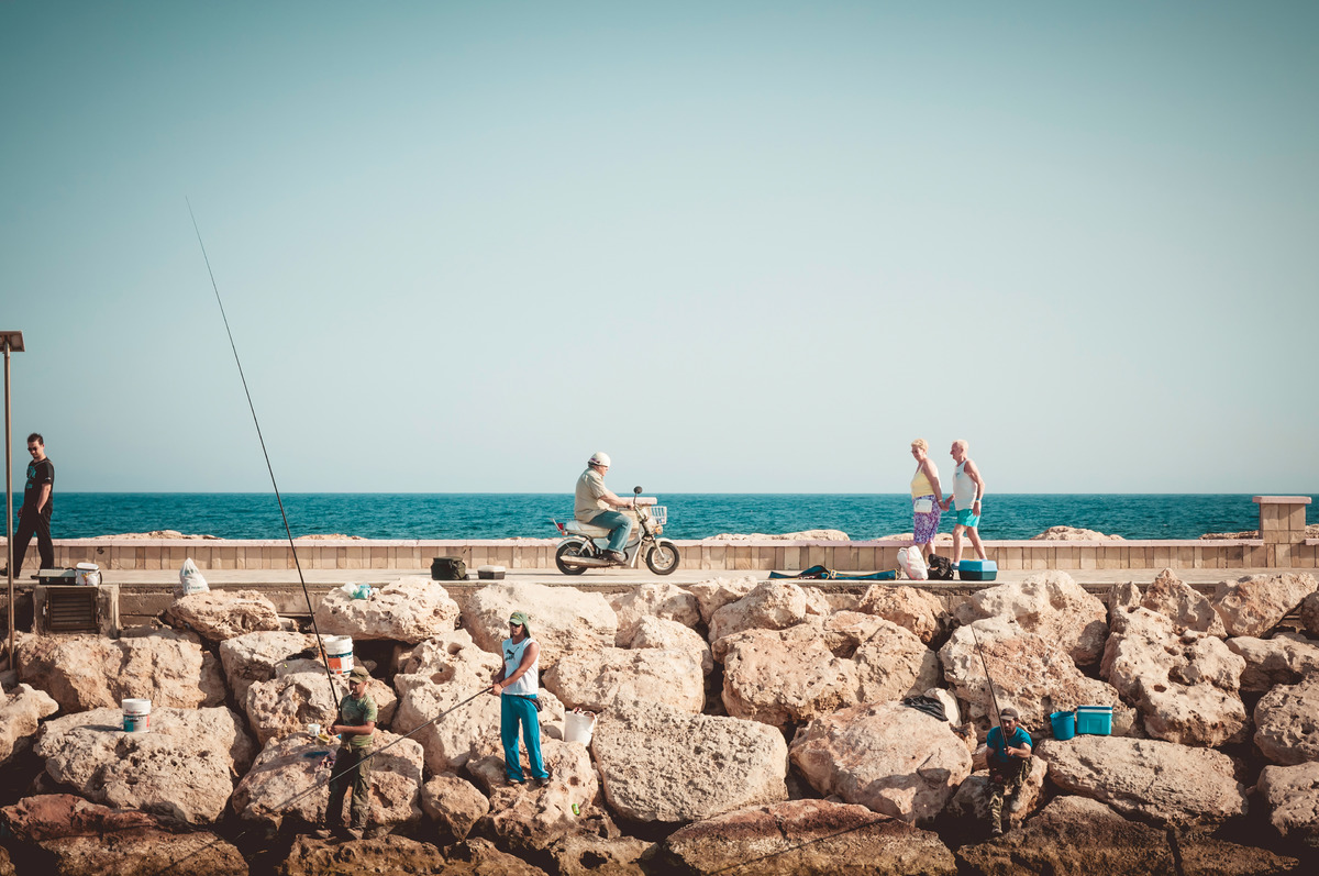 Various people along the harbor waterfront. Mediterranean - slon.pics - free stock photos and illustrations