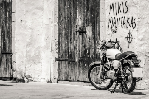 Vintage motorcycle parked near concrete wall - slon.pics - free stock photos and illustrations