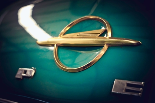 Close-up of an old Opel logo on a turquoise 1960 Rekord - slon.pics - free stock photos and illustrations