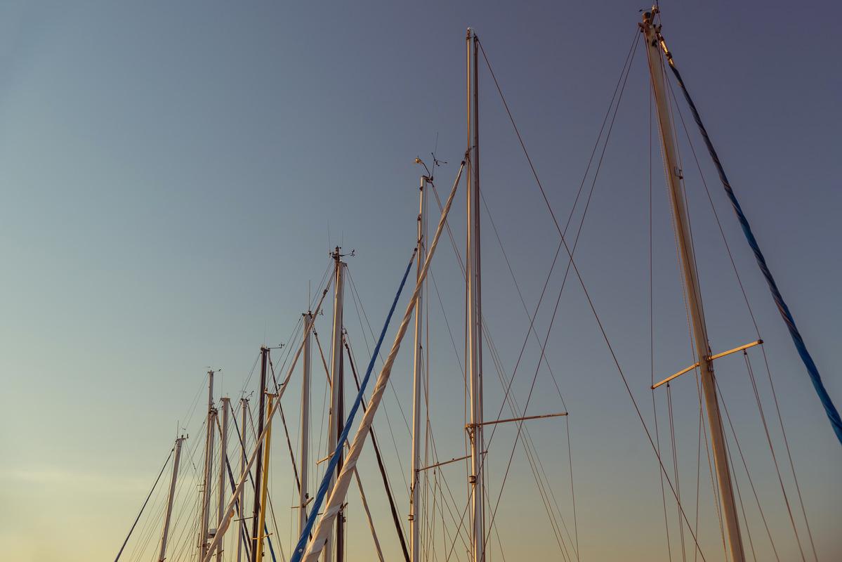 Sailboat masts in marina at dusk - slon.pics - free stock photos and illustrations
