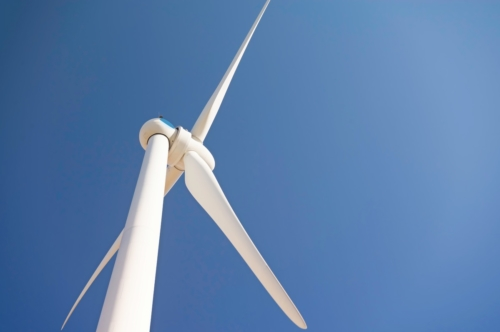 Wind turbine against a blue sky - slon.pics - free stock photos and illustrations