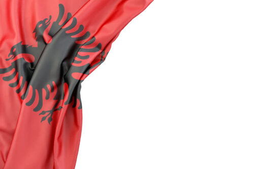 Flag of Albania in the corner on white background. Isolated, contains clipping path - slon.pics - free stock photos and illustrations