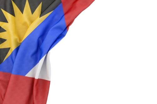 Flag of Antigua and Barbuda in the corner on white background. Isolated, contains clipping path - slon.pics - free stock photos and illustrations