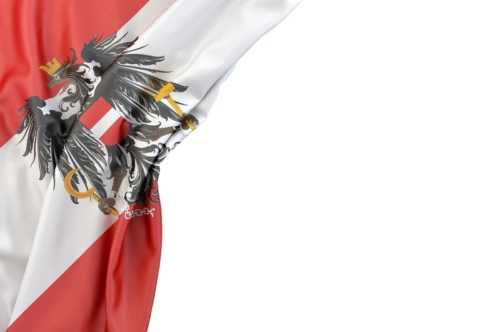 Flag of Austria with coat of arms in the corner on white background. Isolated, contains clipping path - slon.pics - free stock photos and illustrations
