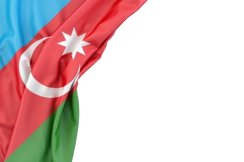Flag of Azerbaijan in the corner on white background. Isolated, contains clipping path - slon.pics - free stock photos and illustrations