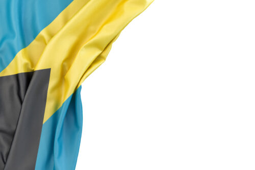 Flag of Bahamas in the corner on white background. Isolated, contains clipping path - slon.pics - free stock photos and illustrations