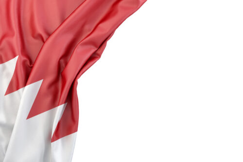 Flag of Bahrain in the corner on white background. Isolated, contains clipping path - slon.pics - free stock photos and illustrations