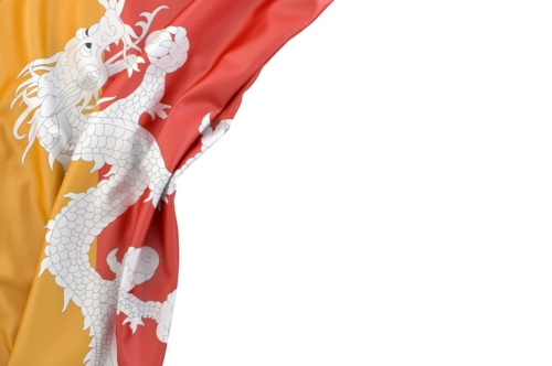 Flag of Bhutan in the corner on white background. Isolated, contains clipping path - slon.pics - free stock photos and illustrations