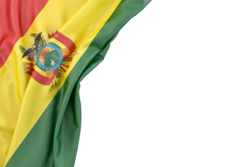 Flag of Bolivia in the corner on white background. Isolated, contains clipping path - slon.pics - free stock photos and illustrations