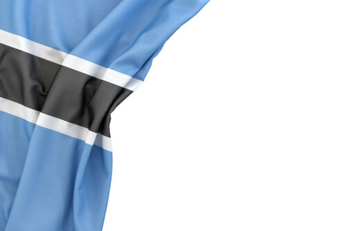 Flag of Botswana in the corner on white background. Isolated, contains clipping path - slon.pics - free stock photos and illustrations