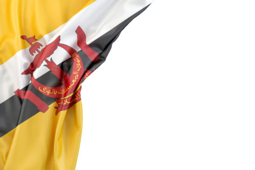Flag of Brunei in the corner on white background. Isolated, contains clipping path - slon.pics - free stock photos and illustrations
