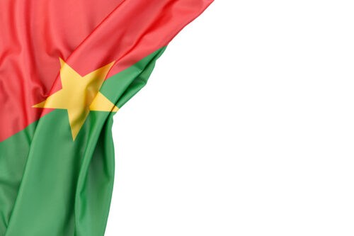 Flag of Burkina Faso in the corner on white background. Isolated, contains clipping path - slon.pics - free stock photos and illustrations