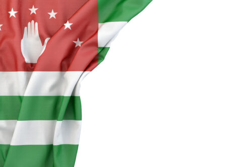 Flag of Abkhazia in the corner on white background. Isolated, contains clipping path - slon.pics - free stock photos and illustrations