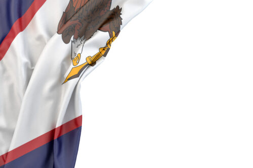 Flag of American Samoa in the corner on white background. Isolated, contains clipping path - slon.pics - free stock photos and illustrations