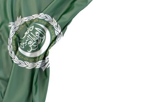 Flag of Arab League in the corner on white background. Isolated, contains clipping path - slon.pics - free stock photos and illustrations