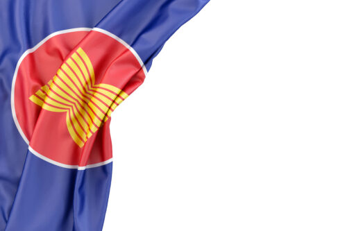 Flag of Association Of Southeast Asian Nations (ASEAN) in the corner on white background. Isolated, contains clipping path - slon.pics - free stock photos and illustrations