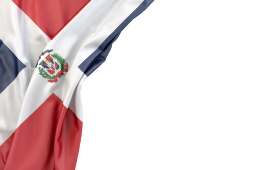 Flag of Dominican Republic in the corner on white background. Isolated, contains clipping path - slon.pics - free stock photos and illustrations