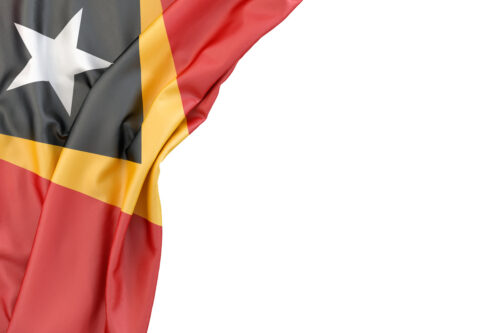 Flag of East Timor in the corner on white background. Isolated, contains clipping path - slon.pics - free stock photos and illustrations