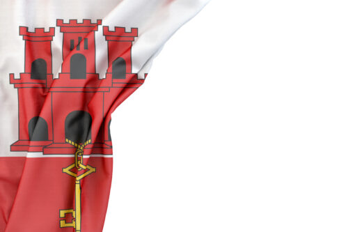 Flag of Gibraltar in the corner on white background. Isolated, contains clipping path - slon.pics - free stock photos and illustrations