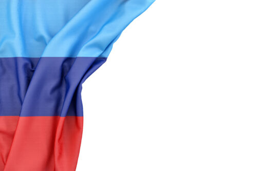 Flag of Lugansk People's Republic in the corner on white background. Isolated, contains clipping path - slon.pics - free stock photos and illustrations