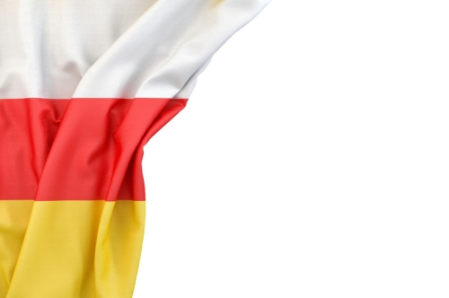 Flag of South Ossetia in the corner on white background. Isolated, contains clipping path - slon.pics - free stock photos and illustrations