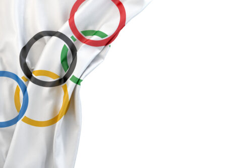 Olympics flag in the corner on white background. Isolated, contains clipping path - slon.pics - free stock photos and illustrations