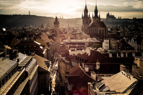 A late evening elevated view towers of the Church of Our Lady before Tyn and the Old Town Hall in Prague, Czech Republic - slon.pics - free stock photos and illustrations