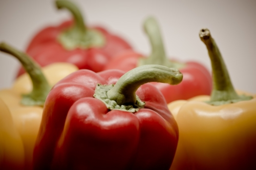 Close up of mixed yellow and red fresh bell peppers - slon.pics - free stock photos and illustrations