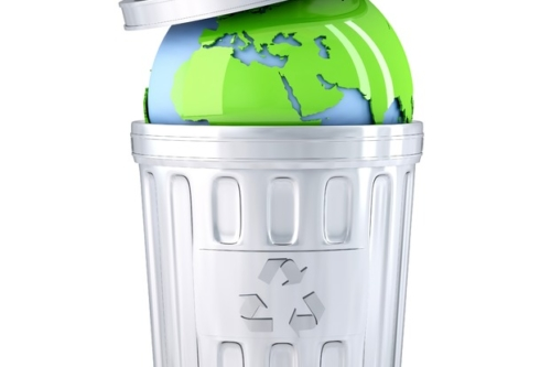 Earth globe in a recycle bin. Global environment concept. Isolated - slon.pics - free stock photos and illustrations