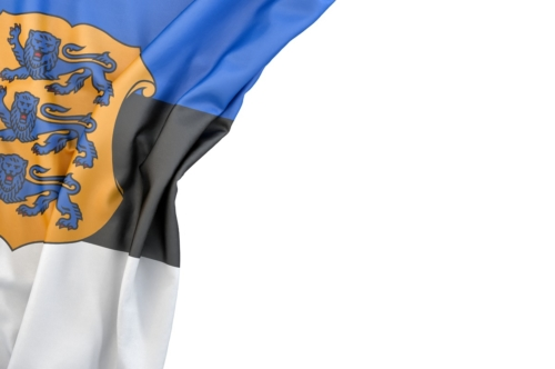 Flag of Estonia with coat of arms in the corner on white background. Isolated, contains clipping path - slon.pics - free stock photos and illustrations