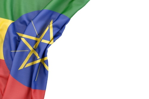 Flag of Ethiopia in the corner on white background. Isolated, contains clipping path - slon.pics - free stock photos and illustrations