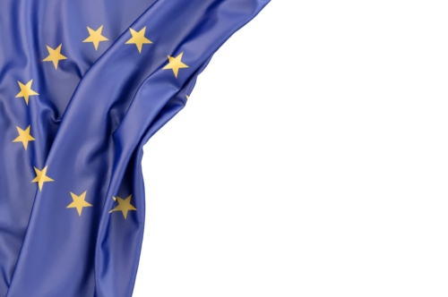 Flag of European Union in the corner on white background. Isolated, contains clipping path - slon.pics - free stock photos and illustrations
