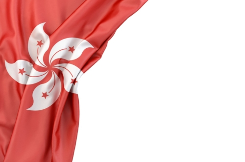 Flag of Hong Kong in the corner on white background. Isolated, contains clipping path - slon.pics - free stock photos and illustrations