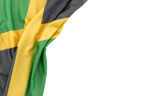Flag of Jamaica in the corner on white background. Isolated, contains clipping path - slon.pics - free stock photos and illustrations