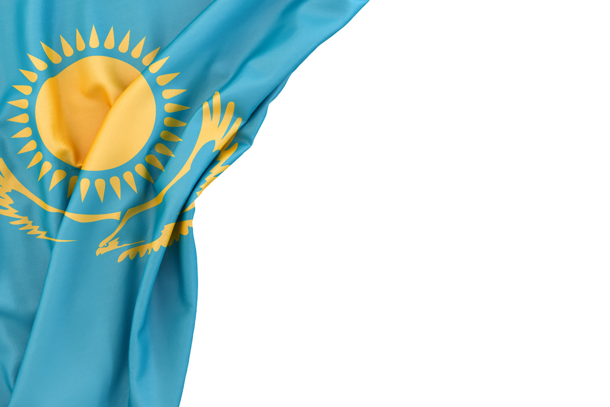 Flag of Kazakhstan in the corner on white background. Isolated, contains clipping path - slon.pics - free stock photos and illustrations