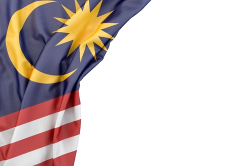 Flag of Malaysia in the corner on white background. Isolated, contains clipping path - slon.pics - free stock photos and illustrations