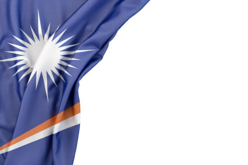 Flag of Marshall Islands in the corner on white background. Isolated, contains clipping path - slon.pics - free stock photos and illustrations