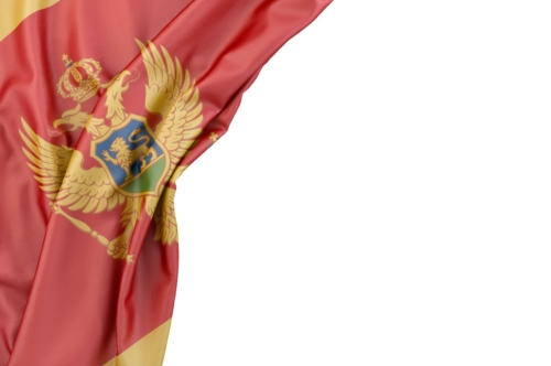 Flag of Montenegro in the corner on white background. Isolated, contains clipping path - slon.pics - free stock photos and illustrations