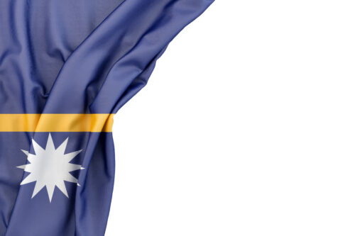 Flag of Nauru in the corner on white background. Isolated, contains clipping path - slon.pics - free stock photos and illustrations