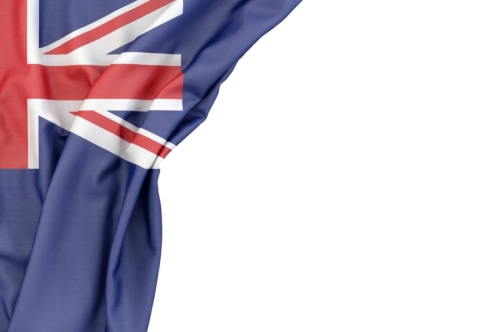 Flag of New Zealand in the corner on white background. Isolated, contains clipping path - slon.pics - free stock photos and illustrations