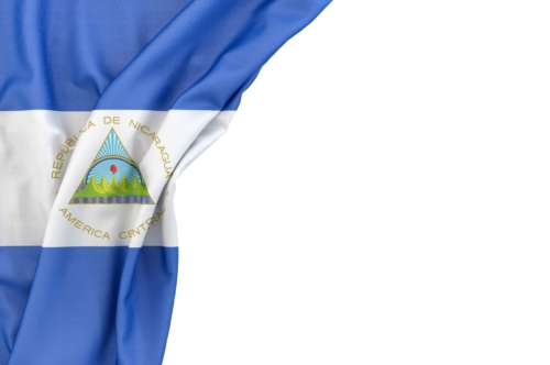 Flag of Nicaragua in the corner on white background. Isolated, contains clipping path - slon.pics - free stock photos and illustrations