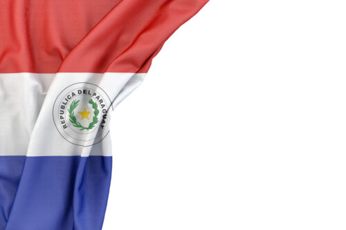 Flag of Paraguay in the corner on white background. Isolated, contains clipping path - slon.pics - free stock photos and illustrations