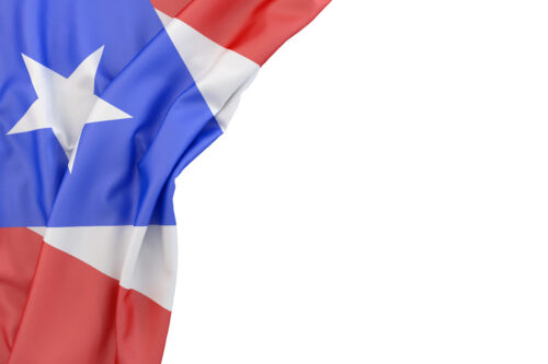 Flag of Puerto Rico in the corner on white background. Isolated, contains clipping path - slon.pics - free stock photos and illustrations