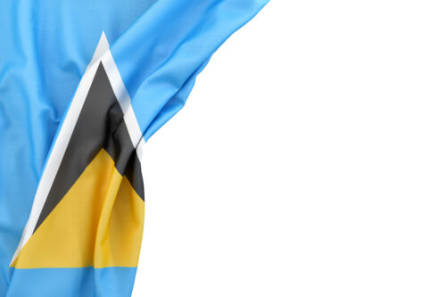 Flag of Saint Lucia and Nevis in the corner on white background. Isolated, contains clipping path - slon.pics - free stock photos and illustrations