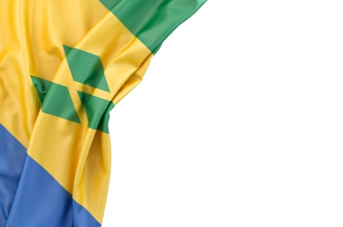 Flag of Saint Vincent and the Grenadines and Nevis in the corner on white background. Isolated, contains clipping path - slon.pics - free stock photos and illustrations